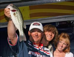 Joined by his son Sonny and girlfriend Chariti Wilkins, Roy Hawk shows off one of his winning bass.