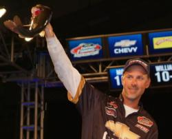 Second-place pro Andy Morgan holds up his kicker bass from day four on Lake Norman.