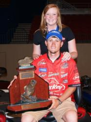 With his fiance at his side, Stetson Blaylock shows off his trophy for winning the 2009 National Guard Open on Lake Norman.