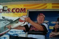Co-angler Debra Cunningham of Phoenix weighed the biggest bass of day three, this 8-pound, 14-ounce largemouth.