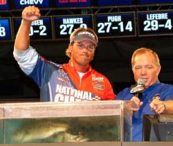 National Guard pro Scott Martin celebrates after learning he won the Walmart FLW Tour event on Lake Champlain.