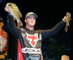 Fourth-place pro Cody Meyer holds up two nice smallmouths he caught on day two of the Forrest Wood Cup.