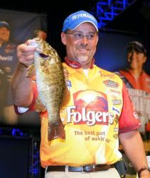 Third-place pro Scott Suggs holds up a nice smallmouth he caught on day two of the Forrest Wood Cup.
