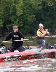 Second-place pro Dave Lefebre hoists a keeper smallmouth Friday morning.