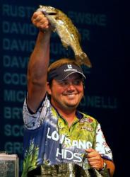 Pro winner Greg Hackney holds up his biggest bass from day four on the Three Rivers.
