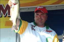 Crowd favorite Chad Kerrof Burlington, Iowa, proudly displays part of his second-place catch during the Stren Series event at Fort Madison.