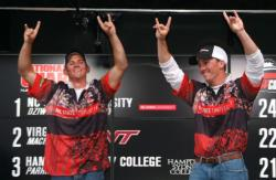 North Carolina State anglers Kevin Beverley and Ben Dziwulski give the Wolfpack sign after celebrating their comeback victory.