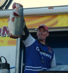 Pro Keith Combs holds up a giant Falcon Lake bass he caught on day three. Combs finished the event in second place.