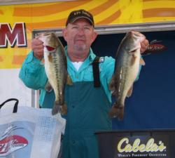 Second-place co-angler Darrell Mitchell holds up his two biggest bass from day one.