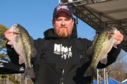 Shane Melton caught three bass Thursday weighing 6 pounds, 15 ounces to retain his lead in the Co-angler Division.