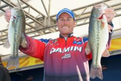 Third-place pro Bryan Thrift holds up his two biggest bass from day three.