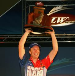 With trophy in hand, Brent Ehrler celebrates after winning the FLW Tour event on Table Rock Lake.