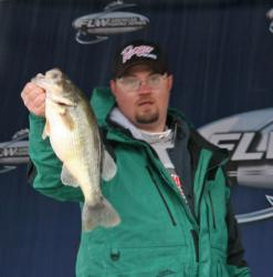Holding at third place, Earl Garrison IV missed his Day Three limit by one fish, but his 12-5 weight showed he was around good fish.