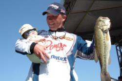 Pro Andy Montgomery of Blacksburg, S.C. Montgomery shows off his catch with a little one in tow. Montgomery finished Wednesday's competition with a total catch of 14 pounds, 5 ounces.