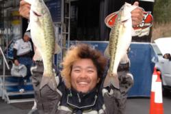 Naohiro Maruo of Takamatsu Kagawa, Japan, struck a dramatic pose for the camera after finishing in second place heading into the final day of FLW Tour co-angler competition on Lake Norman.