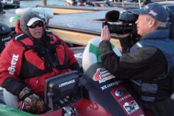 FLW Outdoors television camera crews film second-place qualifier Rusty Trancygier before takeoff.