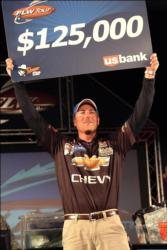 Bryan Thrift of Shelby, N.C. displays his first-place check after capturing the tournament title on Lake Norman.