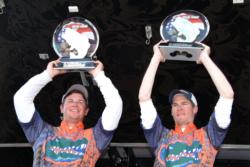 The University of Florida team of Jake Gipson and Matt Wercinski proudly display their first-place trophy after winning the 2010 National Guard FLW College Fishing National Championship on Fort Loudoun Lake. For their efforts, the team won $100,000 in cash and prizes after recording a three-day stringer weighing 29 pounds, 10 ounces.