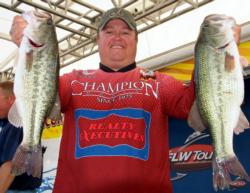 Fourth-place pro James Watson holds up part of his 16-pound, 8-ounce catch.