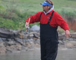 J.T. Kenney pitches a drop-shot to a smallmouth bed.
