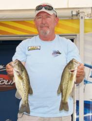 After catching limits on consecutive days, Darrell Mitchell leads the Co-angler Division with a total weight of 18 pounds, 10 ounces.