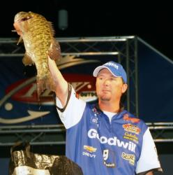 Second-place pro Chad Grigsby holds up a monster smallmouth he caught on day four of the Fort Loudoun-Tellico event.