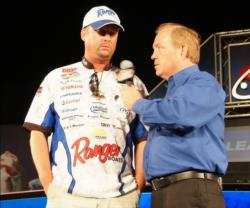 Co-angler Randy Pierson of Oakdale, Calif., is in second place with six bass weighing 13-14.