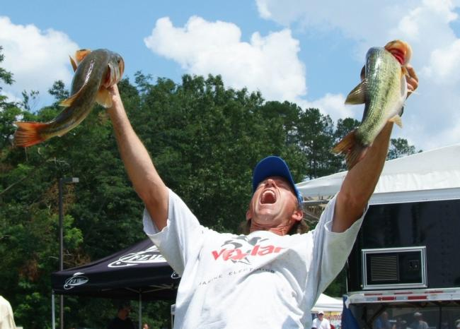 Third-place pro Jim Moynagh celebrates after weighing in a 21-pound, 3-ounce limit.