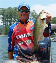 Bryan Thrift holds up one of the bass that helped him clinch Angler of the Year Friday.