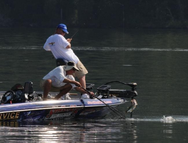 Second place pro Mark Rose hauls in another keeper on day three.