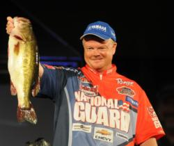 Mark Rose holds up his kicker bass en route to finishing second at Lake Guntersville.