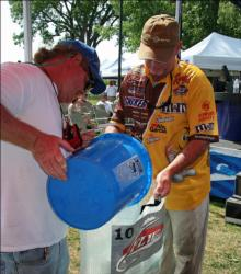 Pro leader Greg Pugh gets a shot of water on his fish after taking the top spot.