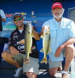 Pro Jason Przekurat and co-angler Bob Allen hold up their day-one catch.