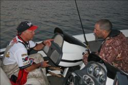Co-angler leader Jeff Misaiko talks strategy with top pro Tom Belinda.