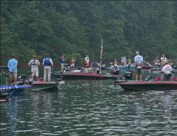 Anglers pause for the playing of the national anthem.