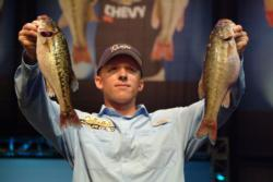 Pro Kevin Hawk of Ramona, Calif., shows off his first-place catch of 14 pounds, 12 ounces during the opening round of 2010 Forrest Wood Cup competition.