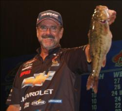 Second-place pro Larry Nixon holds up a Lanier spot that weighed nearly 5 pounds.