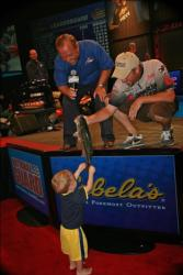 Defending 2009 Forrest Wood Cup co-angler champion Brad Roberts shows off a nice bass to his son Landon, 18 months.