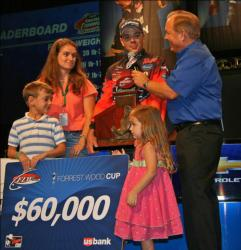Top co-angler Dearal Rodgers discusses his winning tactics with his wife April, son Fisher and daughter Sarah at his side.