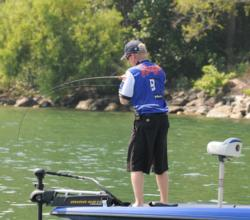 Kevin Hawk fights a fish to the boat on day four of the Forrest Wood Cup.