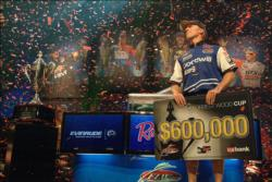 As confetti pours down from the rafters, pro Kevin Hawk of Ramona, Calif., soaks in the moment shortly after wining the 2010 Forrest Wood Cup title on Lake Lanier.