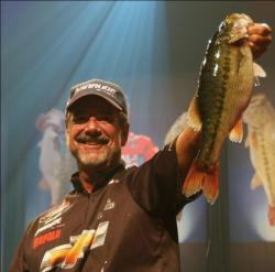 Third-place pro Larry Nixon holds up his biggest bass from day four on Lake Lanier.