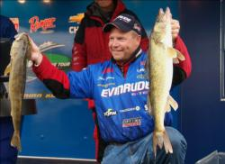 Third-place pro Chris Gilman holds up his two overs from Thursday