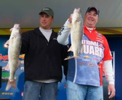 National Guard pro Mark Courts and co-angler Ted Kaminski show off their two overs from Thursday