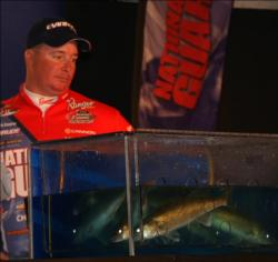 Mark Courts looks on as his 6-pound, 1-ounce limit is registered.