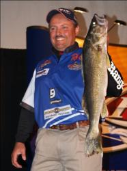 Fourth-place pro Pat Byle holds up his over from day four on Leech Lake.