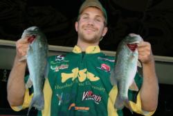 Humboldt State University team member Derrick Hicks proudly displays his team's 7-pound, 4-ounce catch. Humboldt State ultimately qualified for the FLW College Fishing Western Regionals after finishing the Lake Roosevelt event in third place.