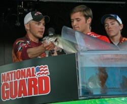Carson Rejzer loads a fish for fifth place Virginia Tech.