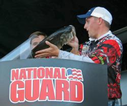 Jeff Bumgarner loads one of his two 6-pounders for NC State.