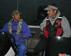 Jeremy Wiggins discusses lake conditions with his co-angler partner David Underwood.